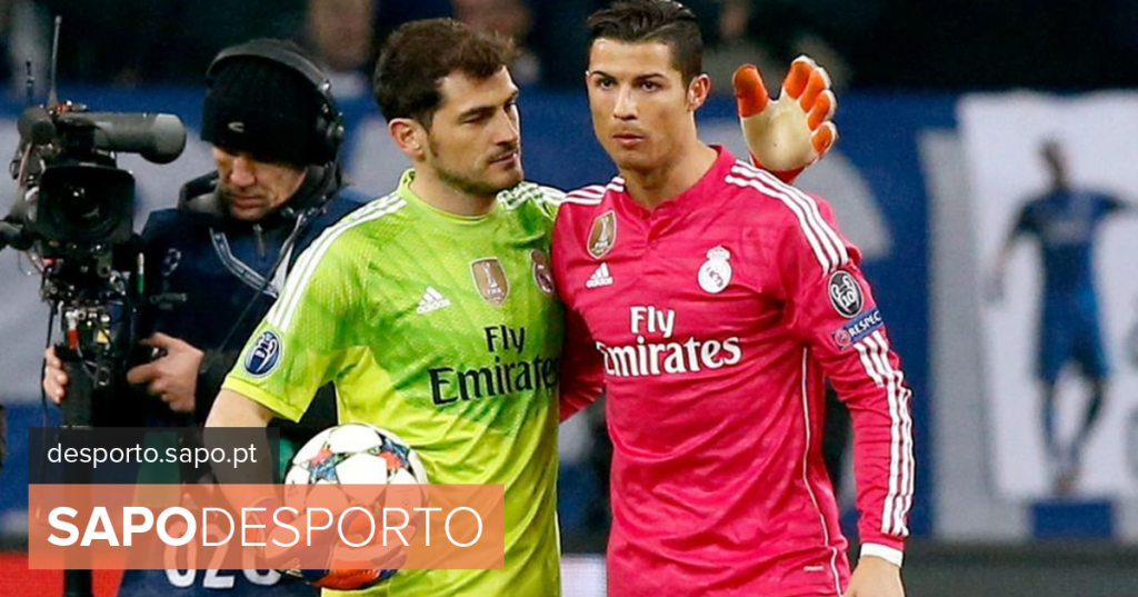 Real Madrid players enter the field with a sweater to support Iker Casillas